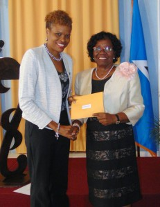 Regional Manager Carole Eleuthere-Jn Marie makes sponsorship presentation to Dame Pearlette Louisy.