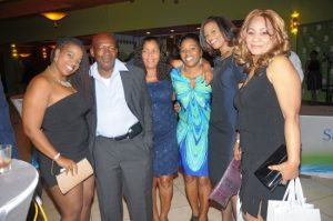 Sagicor staff celebrate with customers and specially invited guests last Friday at Sandals.