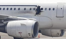 Suicide bomber in wheelchair suspected in mid-flight blast  on Somalian plane