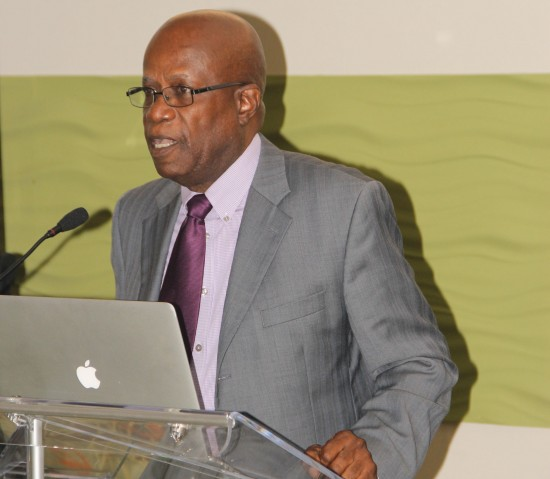 Julian Rogers addressing regional journalists at a media conference in Barbados.