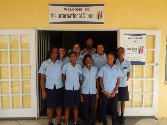 Colin Weekes with students of the International School.