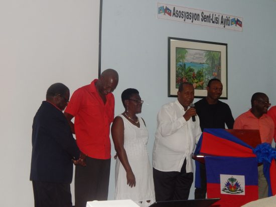 From left to right: Earl Huntley, Cecile Charles, Marie Oscar, Morrison Blanchard (with mic), Junior Cadette, George Victorin.