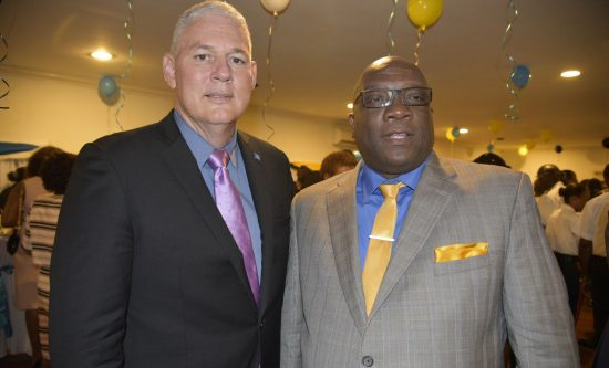 PM Chastanet (left) and PM Harris at a reception following Tuesday's swearing in ceremony.